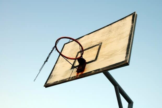 basketball net set on backdrop of blue sky