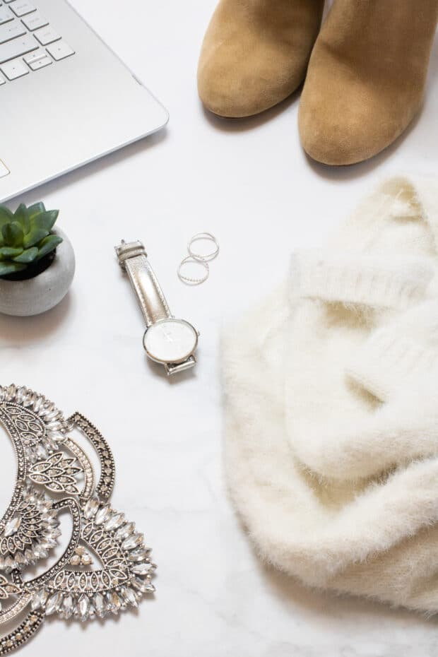 influencer setup with booties watch laptop and jewelry