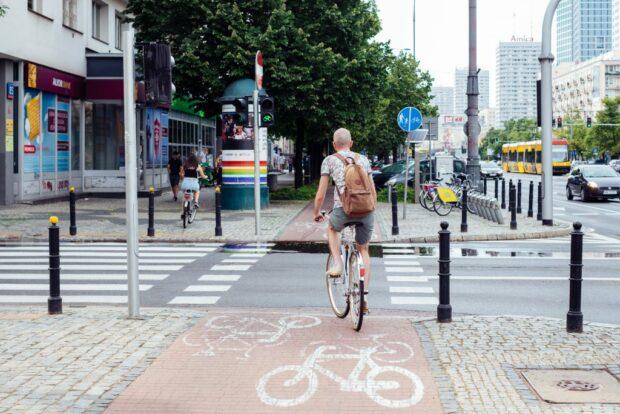cyclist on bike path in urban centre